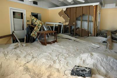 Photo showing hugh amounts of sand in a house.