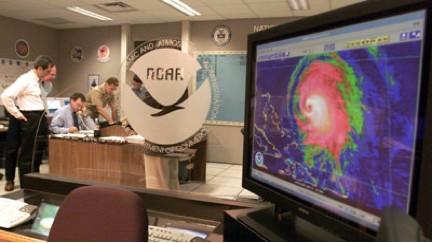 Photograph of forecasters at NOAA's National Hurricane Center. Image credit: NOAA/NHC.