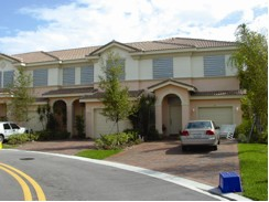 This photograph shows panel hurricane shutters installed on homes along the east coast of Florida.