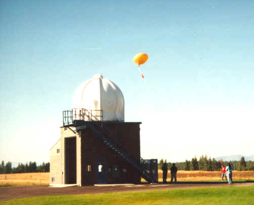 A 1997 radiosonde release (orange balloon) outside a NWS balloon inflation shelter.